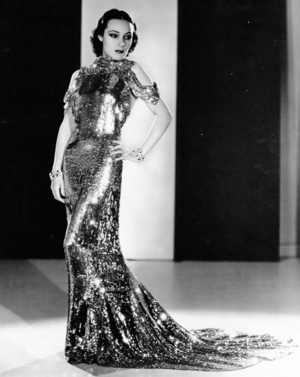 """Wearing an Orry Kelly gown for """"Wonder Bar"""" (1934)"""